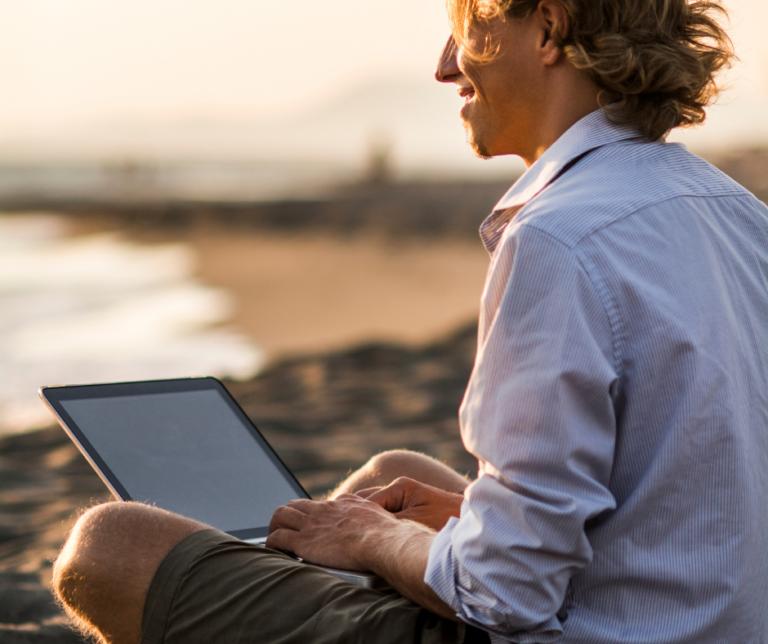 man laptop beach